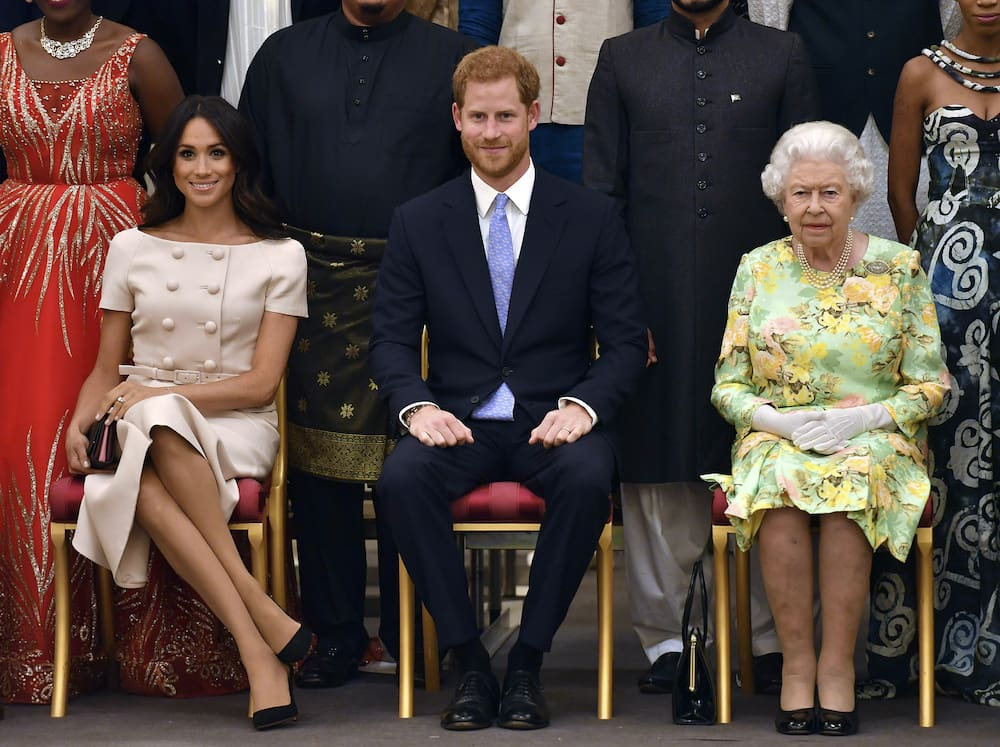 There is a showdown between the Queen and her grandson Harry and his wife Meghan.