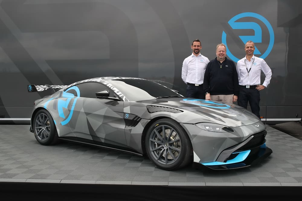 The owners of Aston Martin St. Gallen, Florian Kamelger (left) and Andreas Baenziger (right) stand with Aston boss Andy Palmer at the Vantage Cup racing car from R-Motorsport, the team of the two doctors from Switzerland.
